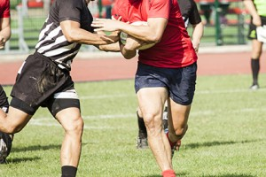 Two rugby players during the game